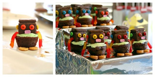 Robot cupcakes: chocolate covered grahams for the head, m's for eyes and bolts, pez for mouth, gummy worms for arms. Glue all together by piping melted chocolate chips.