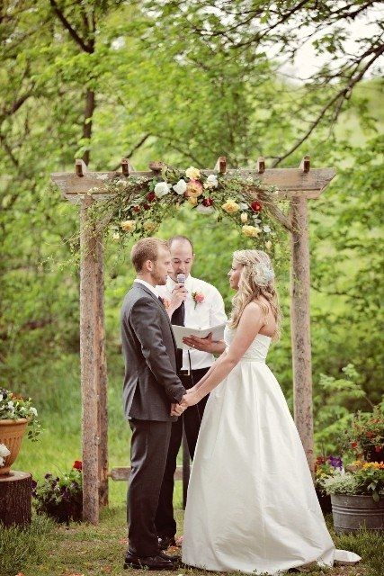 How about a rustic (or not rustic) arbor for the alter?  Maybe tiny lights or lots of tulle and flowers?