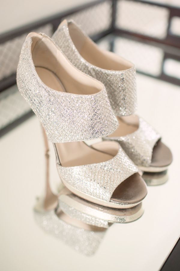 "Jimmy Choo ""Private"" heels, photo by MGB Photo http://ruffledblog.com/manhattan-loft-wedding #weddingshoes #shoes #silver"