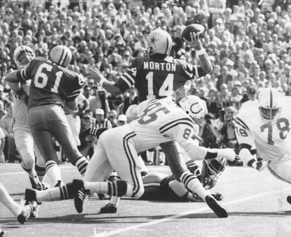 Dallas quarterback Craig Morton is hit from behind by Roy Hilton  in the first period of the Super Bowl. Baltimore Colts beat Cowboys in Super Bowl V, 1971.