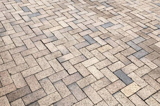 yellow gray cobblestone road pavement