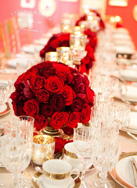 Gorgeous red wedding centerpieces, love the long table and low flowers...so pretty! Would be great for holidays