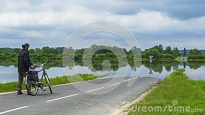 Cyclist in the flooded road in Loire valley, France