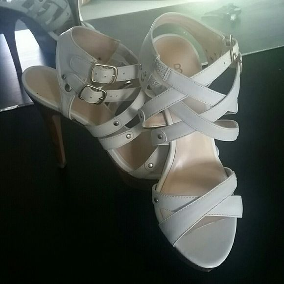 White Strappy Sandals Extremely cute white sandal strap ups. Perfect for spring and summer! Worn once. Bought from Bakers Shoes. Fit kind of tight. Bakers Shoes Sandals