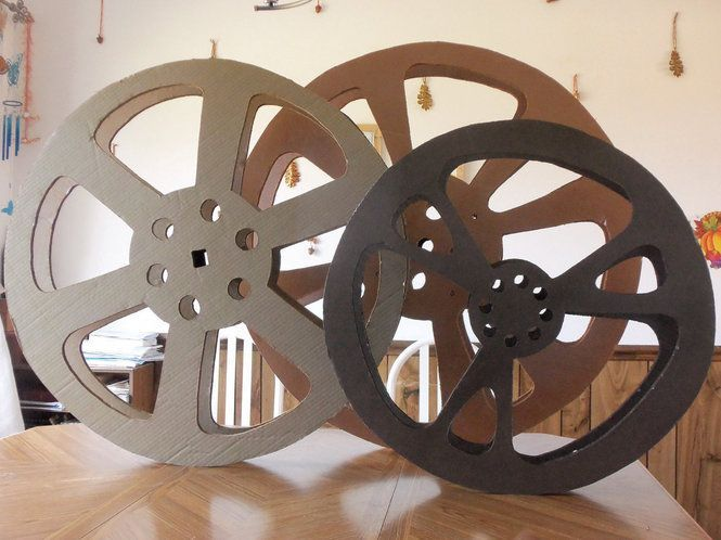 Lights, camera, action! Make your at-home theater room feel more like the real deal with this movie reel made from items around the house.