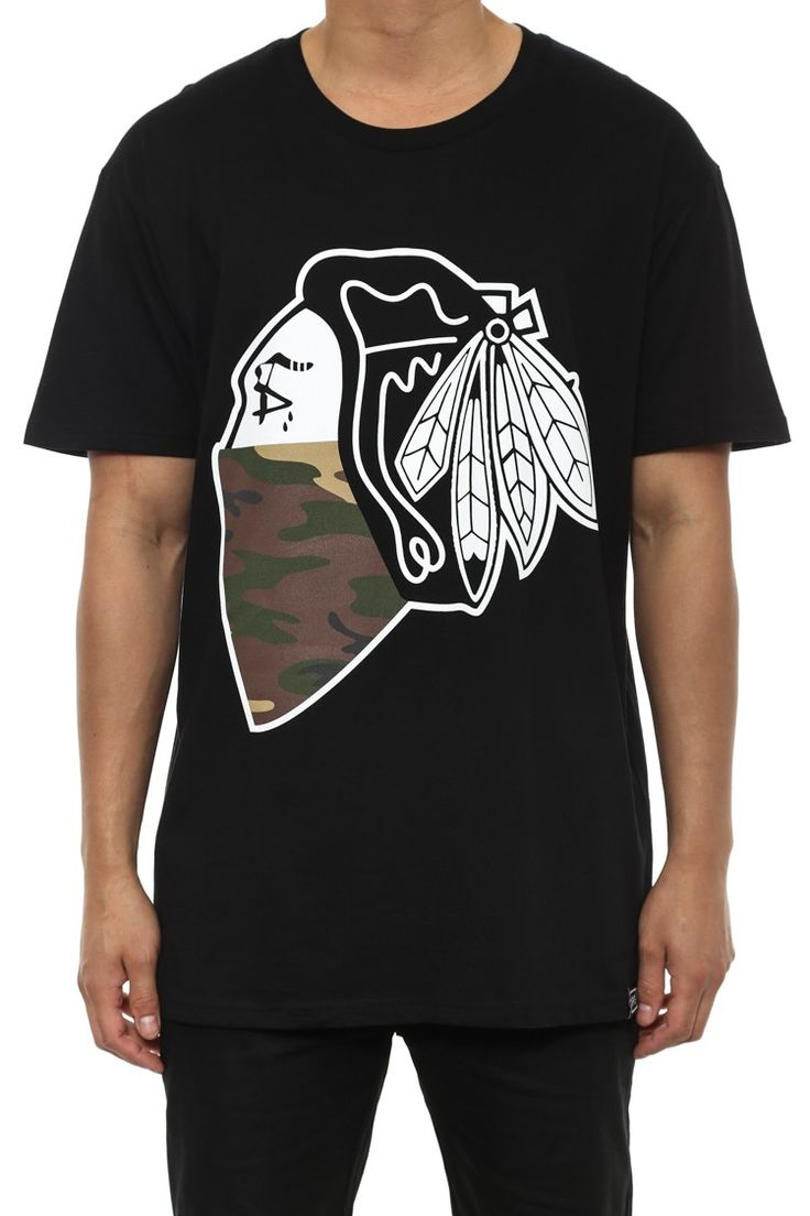Carre Camo Native Tee Black  Carre is the Parisian inspired street wear powerhouse who is the changing face of street fashion having launched street trends on a global scale.   Their game changing innovation and execution of the droptail, Capone and Scission tee have taken street fashion to an unprecedented level. Their impeccable standards for quality fabric, cut and fit coupled with their fashion forward edgy designs and prints have made Carre garments a must have core staple for any…