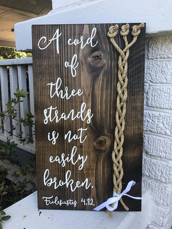 A cord of three strands is not easily broken Rustic wedding sign Unity ceremony A cord of three strands is not easily broken, Ecclesiastes 4:12 Wedding sign decoration meant to be braided at your wedding ceremony or vow renewal service and hung in your home as a keepsake of your special day! This listing features 3 rustic rope cords. Sign measures 11 x 19 (11 x 21 personalized with names and date along the bottom) SIgn comes sealed and ready to hang in your home. Sign will come with cords...