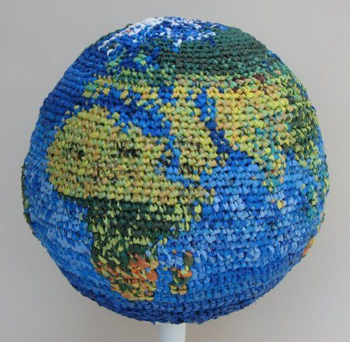 """Artist Julie Kornblum's globe covered in plastic – that is, crocheted plarn (yarn made from plastic bags) – definitely makes a colorful statement about """"plastic covering the Earth."""" For more photos of..."""