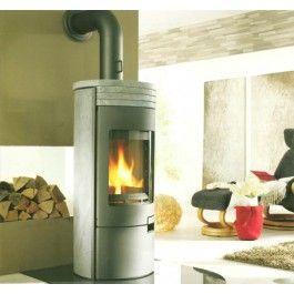 De Koppe Gismo XL is een elegante spekstenen #houthaard die maximaal comfort biedt door de funtionele bedieningselementen. Het trilrooster kan ook bij een gesloten deur bediend worden, zonder dat men zich hoeft te bukken of de deur te openen. De deur van de Koppe Gismo XL, de deurgreep en de deur van het houtvak zijn gemaakt uit hoogwaardig gietijzer. #fireplace #fireplaces