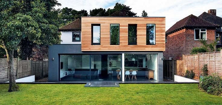 Grey rendered and timber clad extensions by Multi-storey timber extension by 51% Studios AR Design Studio