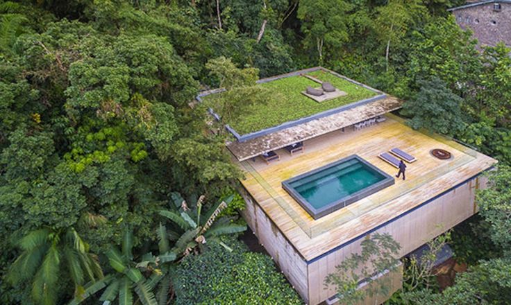 This open-plan villa is a dreamy retreat perched on a lush forested hill in Sao Paulo.