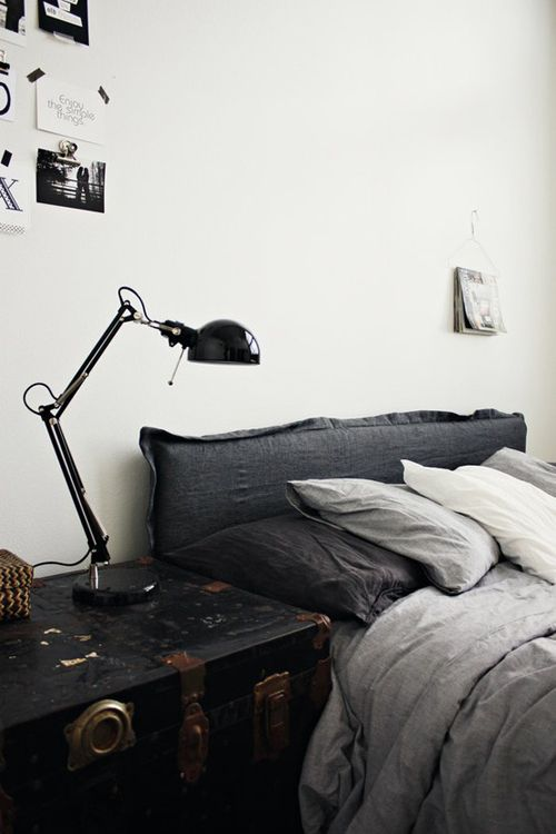 Bedroom for the bachelor - homely but masculine. Love the trunk for side table.