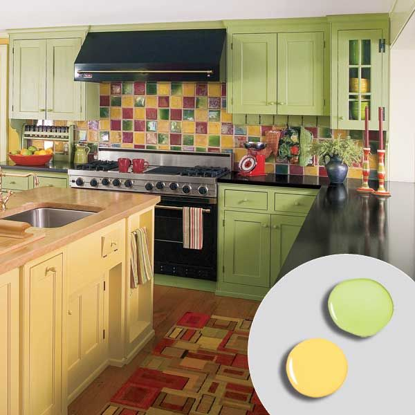 kitchen with bold green painted kitchen cabinets, yellow painted kitchen island and colorful tile backsplash