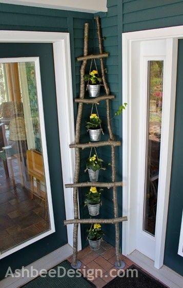Branch ladder for front door display by mariana. Make your own ladder, if you want to.