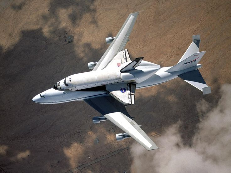 NASA space shuttle Columbia hitched a ride on a special 747 carrier aircraft for the flight from Palmdale, California, to Kennedy Space Center, Florida, on March 1, 2001. Photo Credit: NASA/Jim Ross