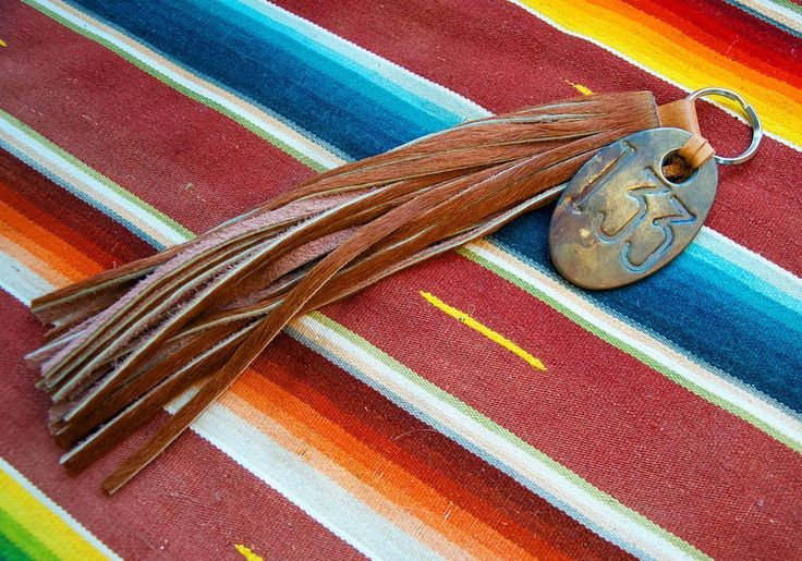 Custom hair on hide tassel keychain with a vintage cattle tag by Calico Gold