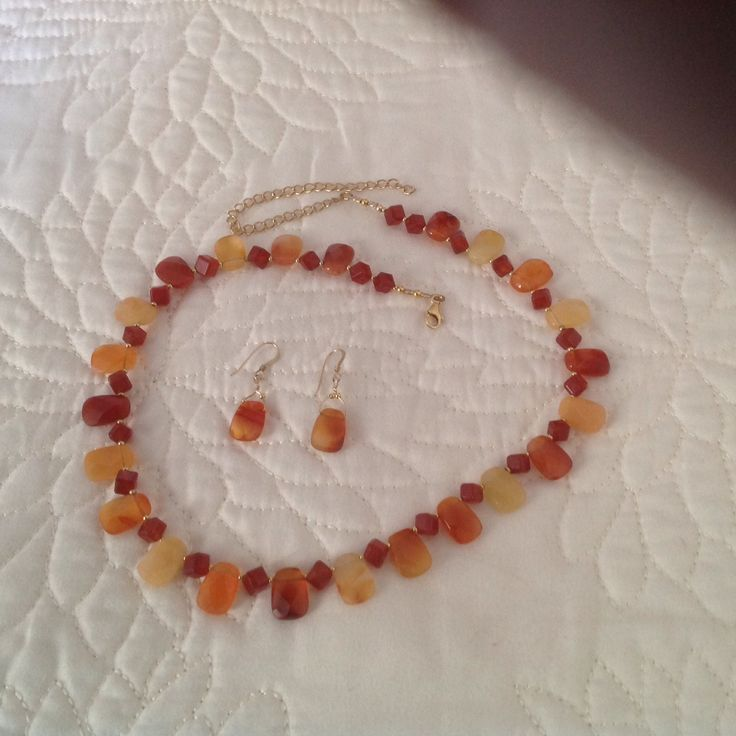 Carnelian and 18 karat gold beads and clasp.