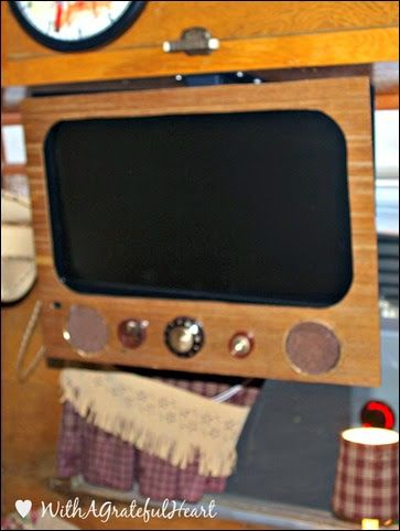 Many of the gals have televisions and DVD players in their trailers.  It makes for good movie-watching late at night.  This sweet friend decided she didn't want just any ordinary flat-screen televisions.  No-sir-ee, she wanted it to look it was vintage.  Her hubby worked to make it just right, complete with vintage knobs.  It almost looks like it's been there since the trailer was built.