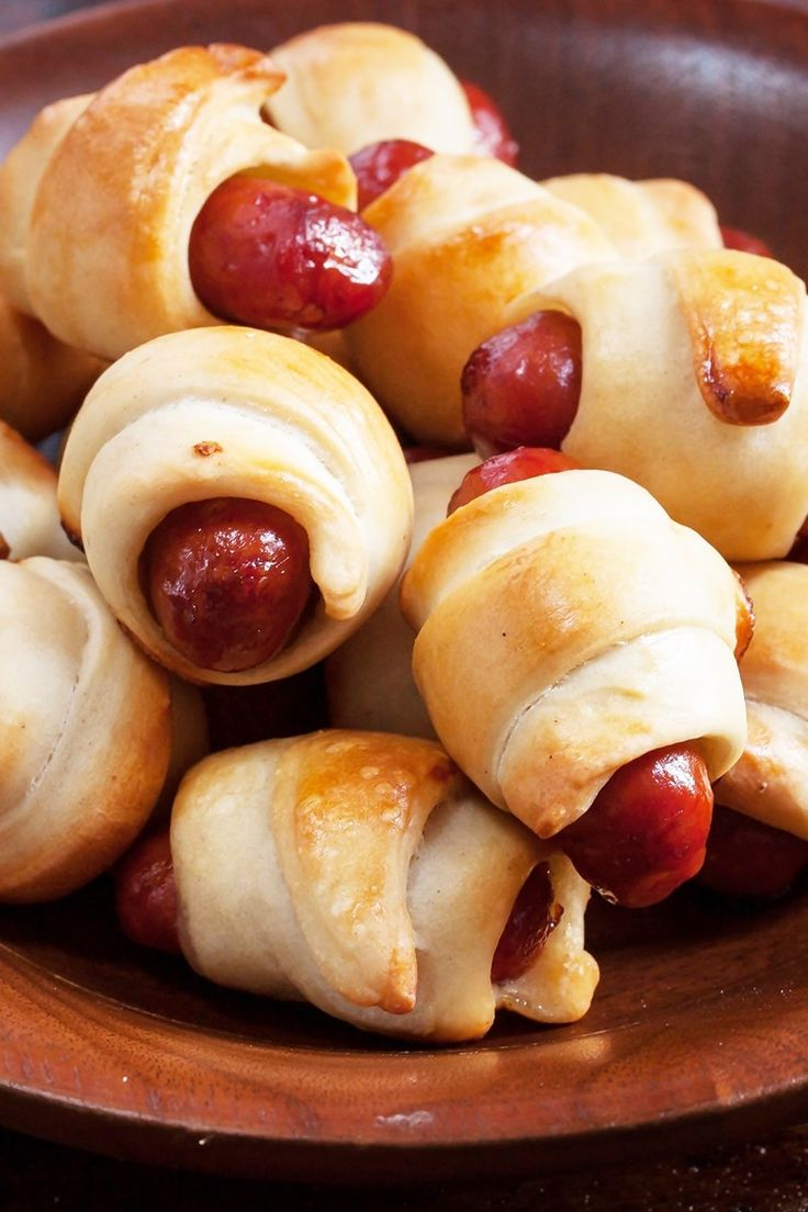 Recipe including course(s): Appetizer; and ingredients: american cheese, crescent roll dough, sausage