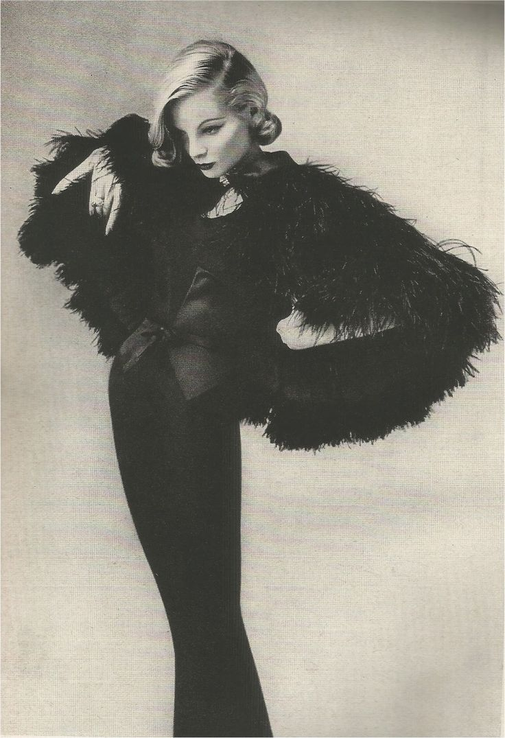 Layers and layers of ostrich feathers over a narrow dress of thin black crepe, inlaid with black satin. Mainbocher, 1955