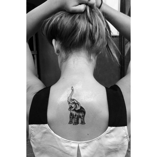 elephant trunk up tattoo