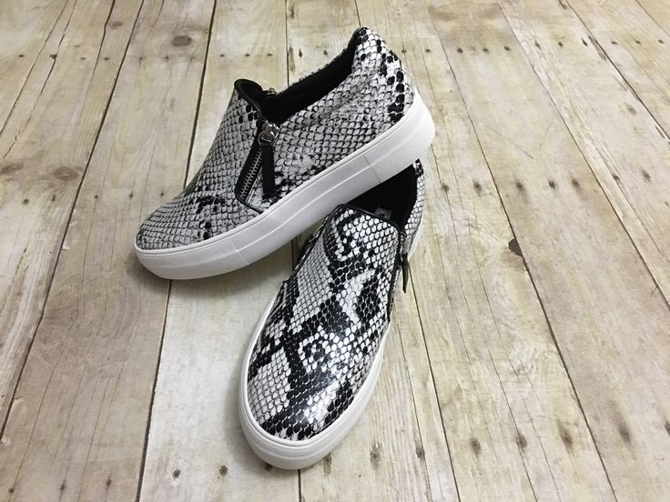 The perfect shoes that goes with so many outfits. Not Rated snake skin tennis shoes with a cute side zip.