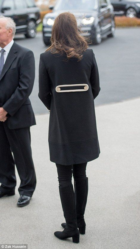 Kate wore a pair of knee-high boots. Nov 22 2017, black Goat coat, third pregnancy, back rear view of coat detail