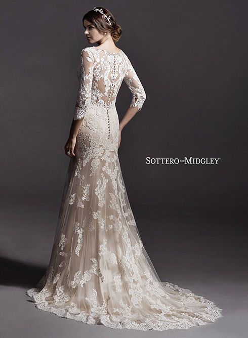 Slim A-line lace wedding dress, complete with illusion lace three-quarter sleeves and V-neckline, adorned with Swarovski crystals. Annora by Sottero and Midgley.