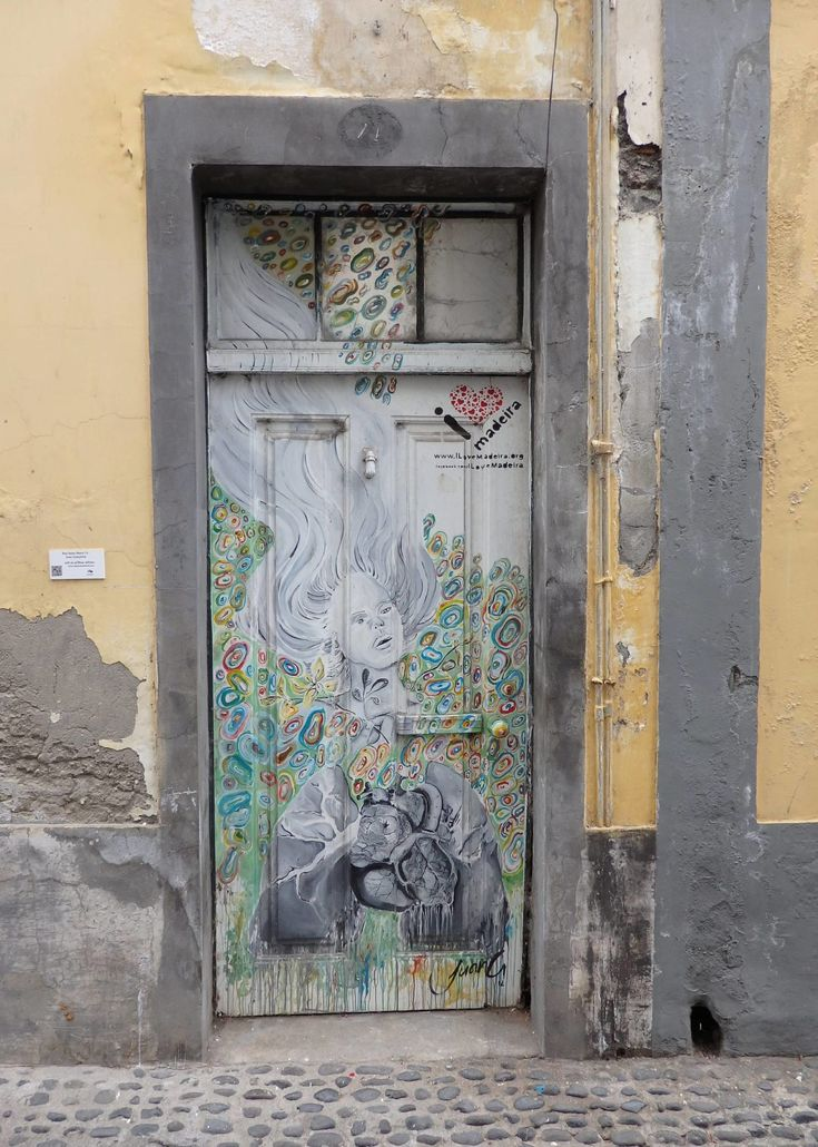 Portugal Travel Inspiration - Exploring Madeira Island then you must check out the painted doors of Funchal, Madeira which are so fun, colourful and quirky; definitely add it to your list of things to do in Funchal. Click the link to read my Madeira Travel Tips! #portugal #madeira #madeiraportugal #travel #80pairsofshoes