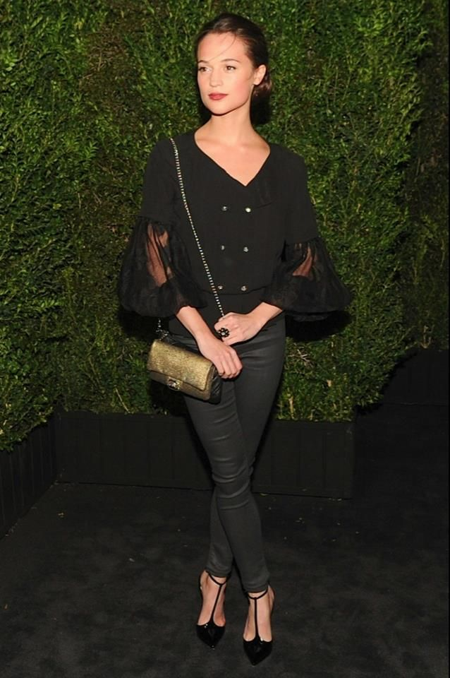 Alicia Vikander wore a black blouse from the Spring/Summer 1 2013 Collection with a gold bag #chanel #oscar #summer