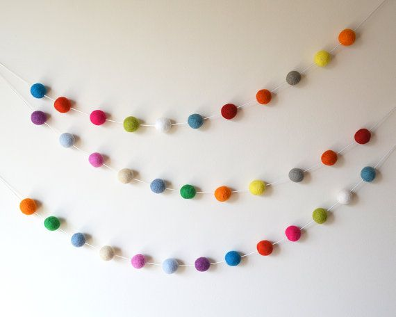 The perfect decoration for your parties and celebrations, for nurseries and kids rooms. Made by hand using beautiful eco friendly pure wool Felt Balls carefully threaded onto a White premium quality waxed cotton cord. This bright and happy garland comes in 3 length options:  * 150 cms (1.5 meters approx. 5 feet) - 25 x Felt Balls * 300 cms (3 meters approx. 10 feet) - 50 x Felt Balls * ...