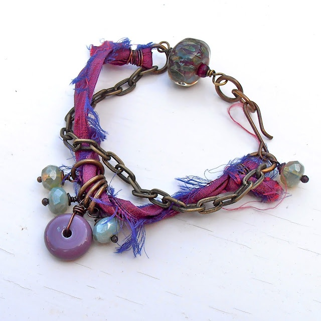 Songbeads- I think this would drive me nuts as a bracelet, but I could see using the idea as inspiration for a necklace. Like the combo of cloth and chain.