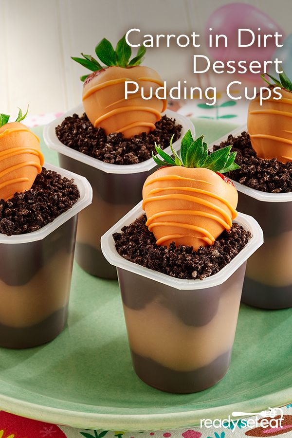 """Get the kids involved this Easter by making these adorable """"carrots"""" in dirt pudding cups for dessert! Dip strawberries in orange-colored candy melts to resemble carrots and place on top of crushed chocolate sandwich cookies in pudding cups."""