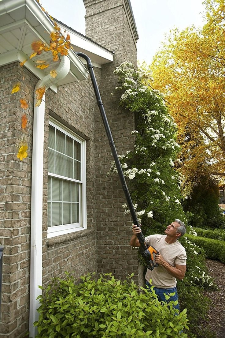 A leaf blower extension kit that lets you keep two feet