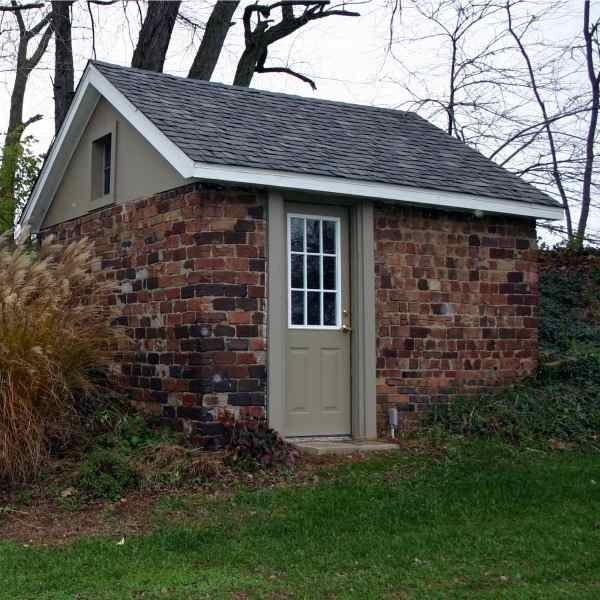 Brick Around Shed With Mulch And Flowers: Nice Place For An Office