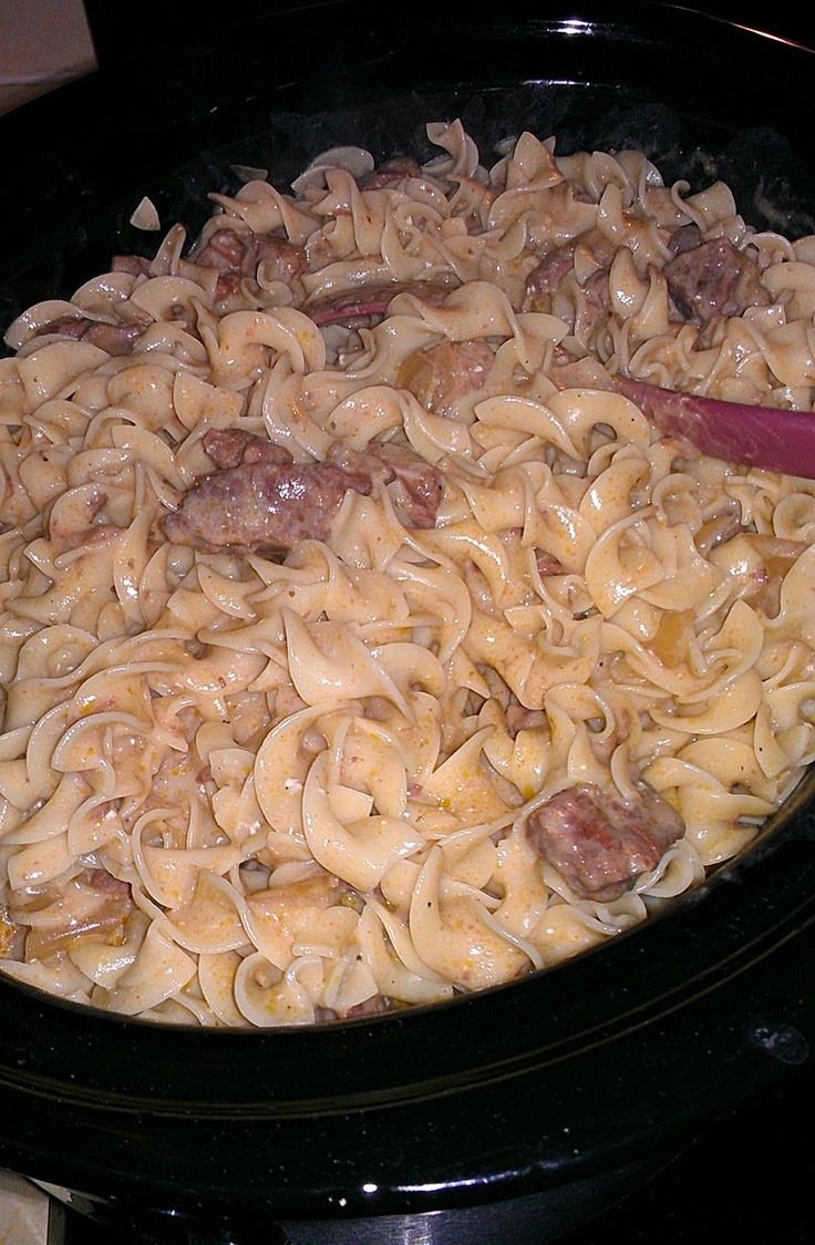 Crockpot Beef Stroganoff: 2 lbs stew beef 2 cans condensed golden mushroom soup (no substitutes!) 1 cup chopped onion 2 Tsp.Worcestershire sauce 1 14 oz can beef broth 8 oz button mushrooms, cleaned and quartered (optional) salt and pepper to taste  8ounces cream cheese, room temperature 1/2 cup sour cream