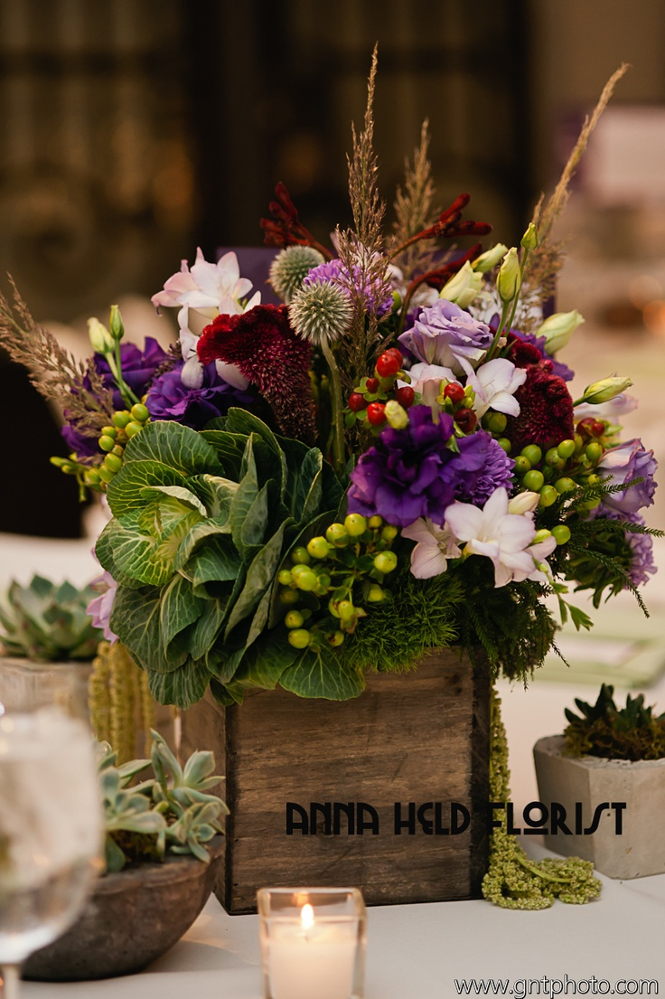 Burgundy, true purple and blue green made up the fun palette of this fall wedding. Kale, freesia, thistle and succulents in a pale gray wooden box. Styled by Anna Held Florist, Chicago.