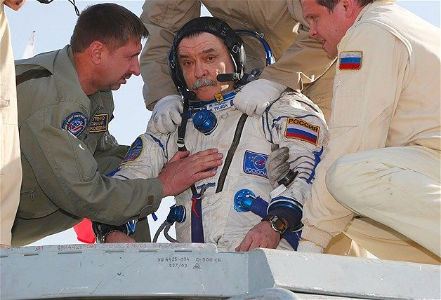Russian cosmonaut Mikhail Tyurin was the first to be taken from the capsule.