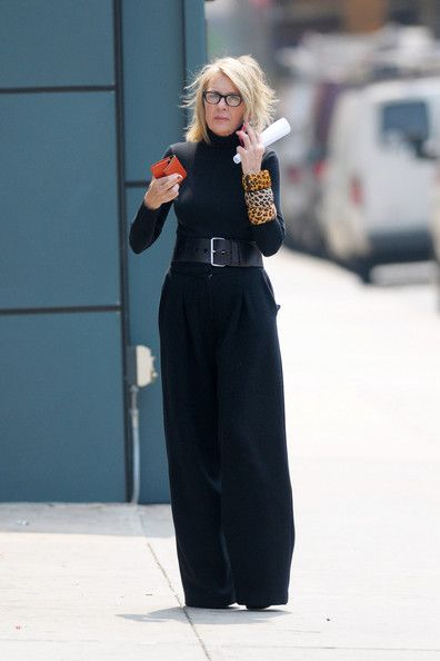 Diane Keaton Actress Diane Keaton, in all black attire, looking chic with several leopard print bangle bracelets on as she chats on her phon...