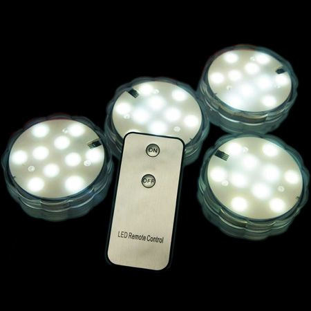 Submersible White LED Lights with Remote Control by Smartyhadaparty.com.  Put them in vases, punch bowls, fountains and more for a colorful ambience.