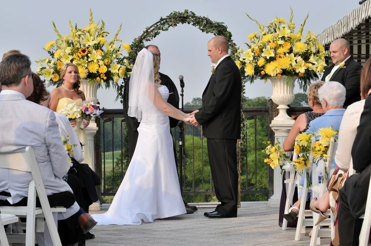 A sun kissed summer wedding ceremony at White Clay Creek Country Club.
