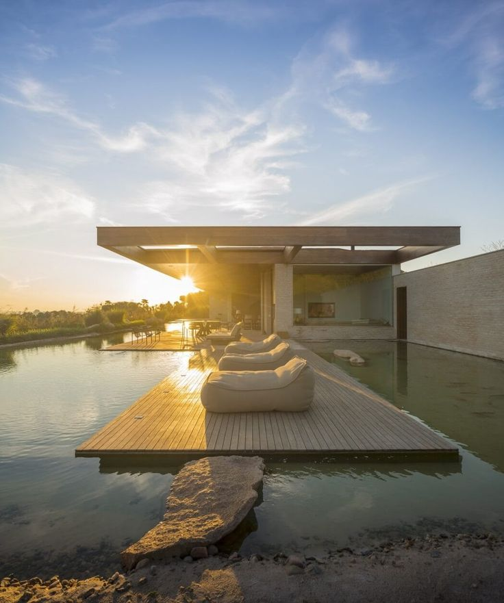 Architecture Modern Summerhouse Opens Up to Large Terrace and Pond in Br...