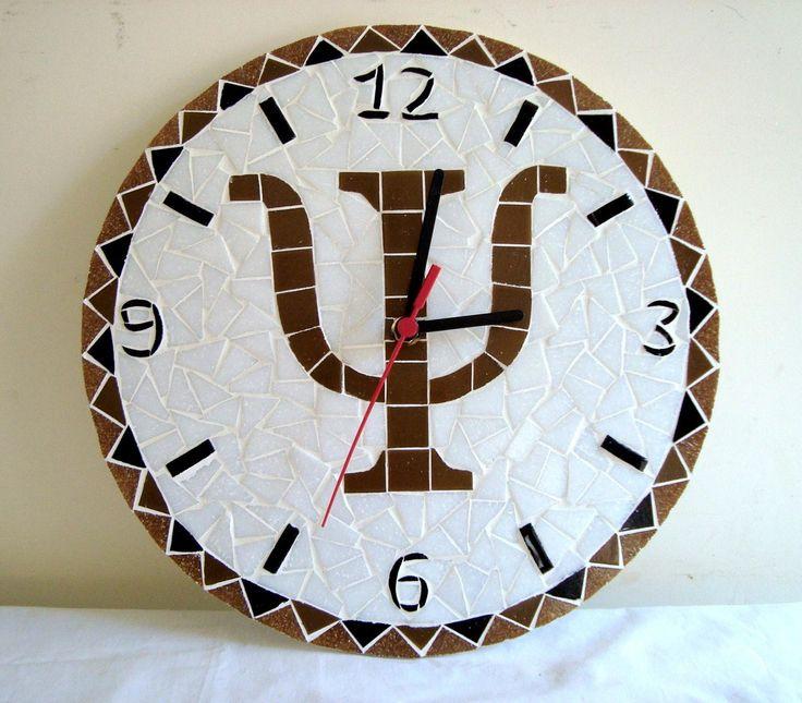 Relógio com simbolo da psicologia medindo 30 cm de diametro. Pode ser feito com outros simbolos.