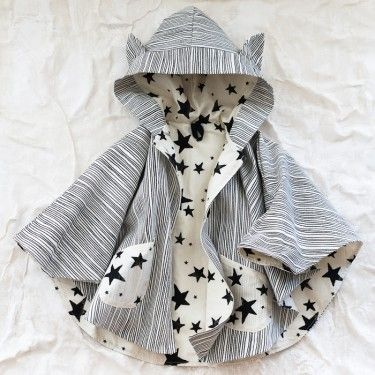 noé & zoë cape - this is TOO ridiculously adorable.  of course i'd have to wait 4 years till my Tiny could wear it.... if it were even in stock that is :(