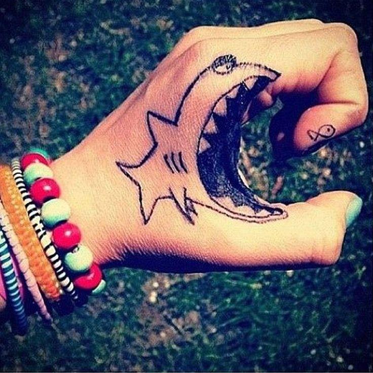 Funny Shark Hand Tattoo tattooideaslive.com #funny #tattoos