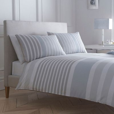 From our exclusive J by Jasper Conran range, this stylish duvet cover is the perfect update for a modern bedroom. Infused with contemporary sophistication, it features a striped design and offers a reversible feature.