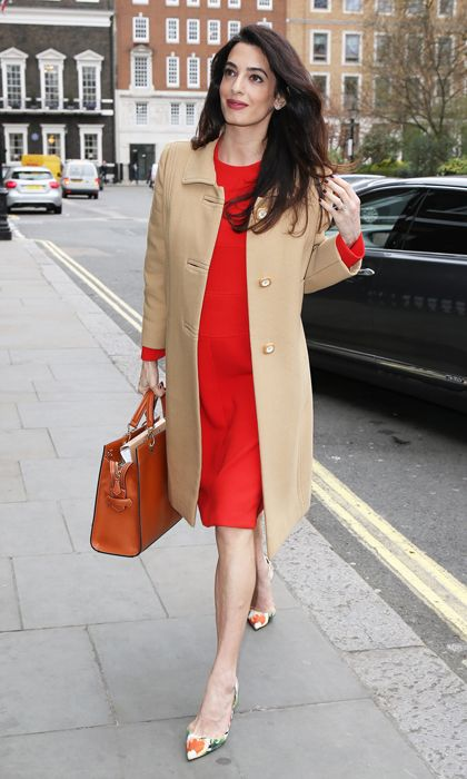 The mom-to-be glowed arriving to the Accountability: International Crimes in Syria and Iraq event held at London's Chatham House. Amal kept her twin bump under-wraps wearing a red Christian Dior dress beneath a camel Balmain coat, which she paired with Oscar de la Renta heels and an Altuzarra shadow bag.