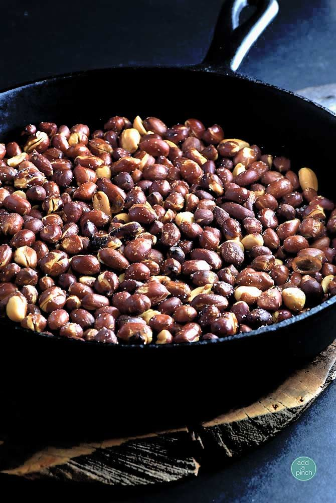 Skillet Roasted Peanuts Recipe -Mercy these are delicious! They have an amazing aroma when they are cooking too! Love these! from addapinch.com