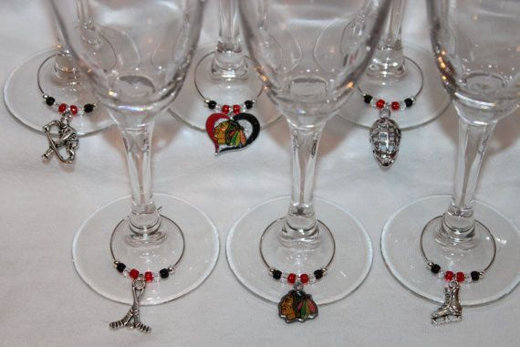 Hey, I found this really awesome Etsy listing at https://www.etsy.com/listing/178018070/chicago-blackhawks-wine-charms-set-of-6