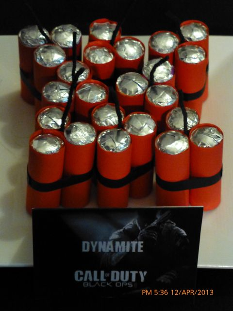 """Dynamite - Cool, but not sure how it's made! Lifesavers, wrapped in red felt maybe?? and black ribbon/yarn to tie them, and black yarn or pipe cleaners for the """"wick""""??"""